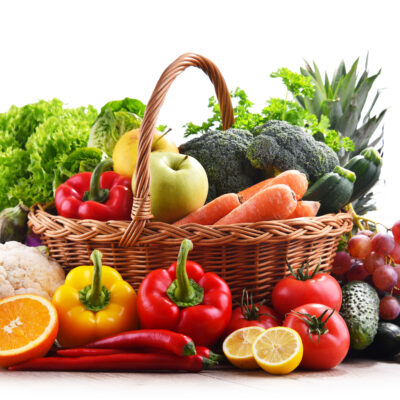 Assorted,Organic,Vegetables,And,Fruits,In,Wicker,Basket,Isolated,On